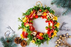 Christmas food background. Christmas wreath of holiday snacks, white background