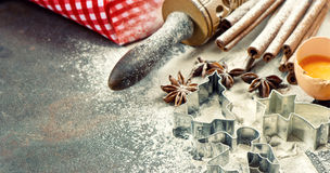 Christmas food. Baking ingredients, spices and tolls. Flour, eggs, rolling pin and cookie cutters stock photography