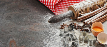 Christmas food. Baking ingredients and tolls for dough preparati Stock Images