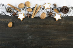 Christmas food, cookies, nuts and spices on wooden background Royalty Free Stock Images