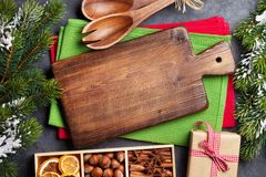 Christmas food decor and cooking utensils. Xmas cooking table and fir tree. Top view Stock Photos