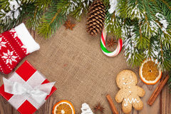 Christmas food, decor and gift box with snow fir tree background Stock Image