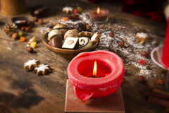 Christmas food decoration  with candle. Christmas food decoration  with red candle Stock Photo