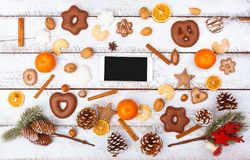 Christmas food flat lay with cell phone on white table stock images
