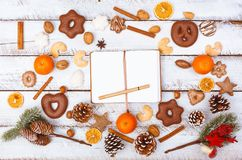 Christmas food flat lay with notepad on white table royalty free stock images