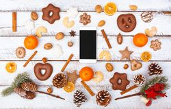 Christmas food flat lay with smart phone on white table stock photography
