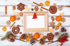 Christmas food flat lay with photo frame on white table stock image