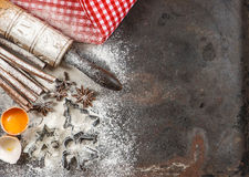 Christmas food. Flour, eggs, spices, rolling pin, cookie cutters Stock Photography