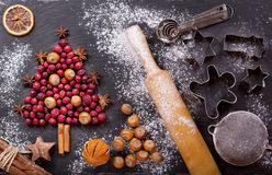 Christmas food. Ingredients for cooking Christmas baking, top vi. Christmas food. Ingredients for cooking Christmas baking: fir tree made from dried cranberries Royalty Free Stock Image