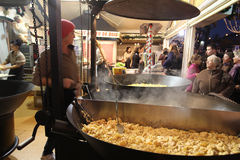 Christmas food market in Paris. Potato with cream Royalty Free Stock Photo