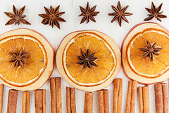 Christmas food - mulled wine background. Decorative frame of spice ingredients -  anise stars, cinnamon, dried oranges and wine on Royalty Free Stock Image