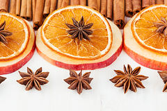 Christmas food - mulled wine background. Decorative frame of spice ingredients - anise stars, cinnamon, dried oranges and wine on Stock Photography