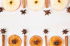 Christmas food - mulled wine background. Decorative frame of spice ingredients - anise stars, cinnamon, dried oranges and wine on Stock Photo