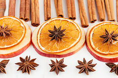 Christmas food - mulled wine background. Decorative frame of spice ingredients - anise stars, cinnamon, dried oranges and wine on Royalty Free Stock Photos
