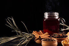 Christmas food - mulled wine. Decorative composition of spices, hot drink on dark black background. Royalty Free Stock Photography