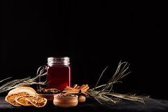 Christmas food - mulled wine. Decorative composition of spices, hot drink on dark black background. Royalty Free Stock Photo