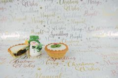 Christmas food photography mince pies and xmas decoration cute snowman on xmas wrapping paper background Stock Photography