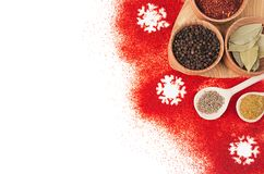 Christmas food - red powder spices and snowflakes isolated on white background, top view. stock image