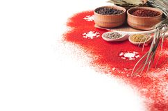 Christmas food - red powder spices and snowflakes on white background, closeup, texture. royalty free stock photos