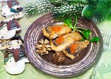 Christmas food - roasted fish Stock Photos