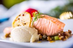 Christmas food with salmon fillet and decoration home hotel or r. Estaurant royalty free stock image