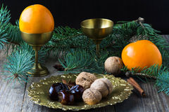Christmas food still life: arabic dates, walnuts, spices Royalty Free Stock Photo