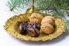 Christmas food still life: arabic dates, walnuts, spices Stock Photos