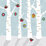 Christmas forest. Robins decorating the forest with christmas ornaments Stock Photos