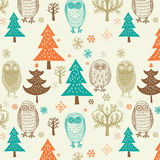 Christmas forest pattern. A seasonal Christmas background with owls, snowflakes and fir trees Stock Photography