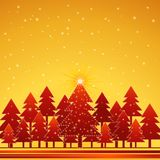 Christmas forest, vector. Christmas card  with forest of pine and snowflakes in the golden  sky,vector illustration Royalty Free Stock Image