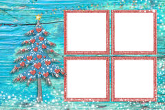 Christmas four empty photo frames card. Christmas photo frames cards, cute tree and four empty frames to put photos over a blue wooden background with stars Royalty Free Stock Photo