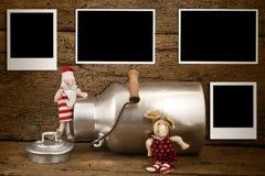 Christmas four empty photos  frames card. Christmas photos frames card, Funny Santa and reindeer  with four empty photos  frames hanging on old wooden wall Stock Photo