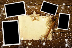 Christmas with four frames to put photos. And write letter in blank paper on wooden background Royalty Free Stock Photo