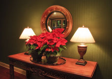 Christmas Foyer. A foyer decorated for Christmas with 2 lamps royalty free stock photography