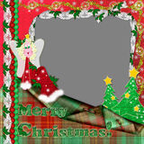 Christmas frame. With an angel, a fur-tree and laces for celebratory photos Royalty Free Stock Photos