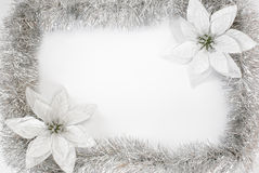Christmas frame. Tinsel and artificial poinsettias Christmas frame stock images