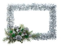 Christmas frame. Christmas composition in form of silver frame over white background Royalty Free Stock Images