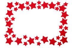 Christmas frame. Made from red star shapes royalty free stock photos