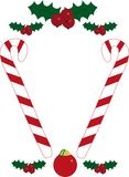 Christmas frame. Frame with christmas ornament, berries and candies Stock Images