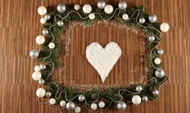 Christmas Frame. With a heart of snow royalty free stock image