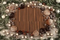 Christmas Frame. Of cookies, stars, balls and snow stock photo