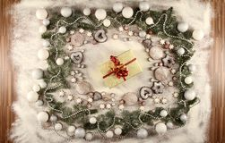 Christmas Frame. Of cookies, stars, balls, snow and a present royalty free stock photos