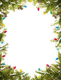 Christmas frame. Pine branches with christmas lights on a white background Royalty Free Stock Photos