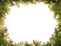 Christmas frame. Pine branches with christmas lights on a white background landscape composition Stock Photos