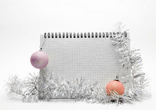 Christmas frame 2. A notebook is decorated fir-tree toys on a white background Royalty Free Stock Photography