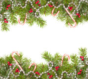 Christmas Frame. Christmas fir tree frame including baubles and candy canes with copy space Royalty Free Stock Photo