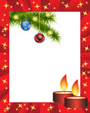 Christmas frame. Red frame is adorned with Christmas candles and fir branches and toys Royalty Free Stock Photo