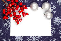 Christmas frame. Silver balls and rosehip twig royalty free stock photos