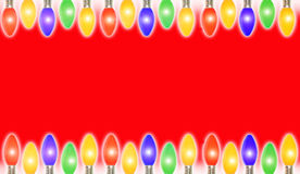 Christmas frame. Colorful glowing christmas holiday lights frame a red background. Add your own text or copy royalty free stock photo
