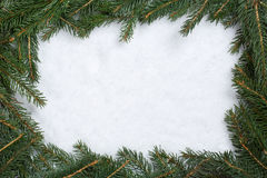 Christmas frame background with fir branches, snow and copyspace Royalty Free Stock Image